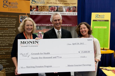 Bob Hager from Monin presenting a $25K donation to Grounds for Health